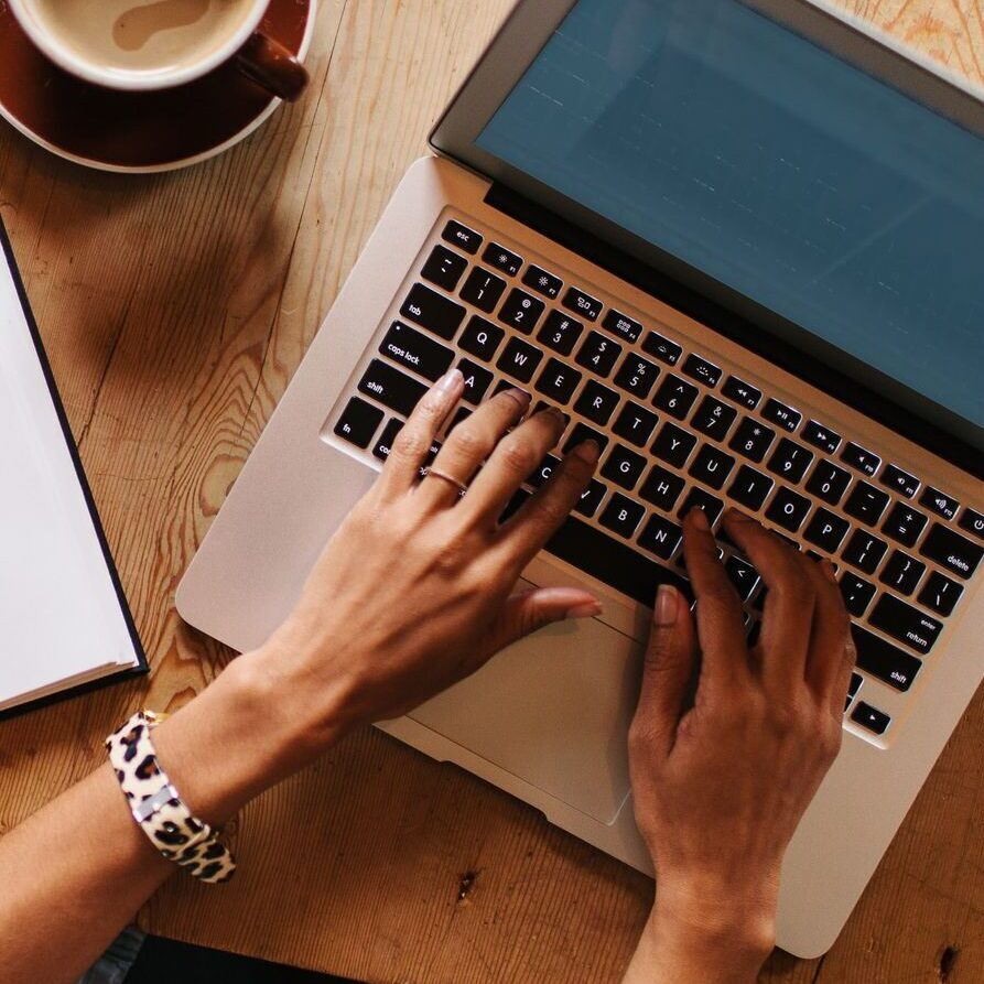 writer on computer at Whisenhunt Communications PR and Marketing Firm